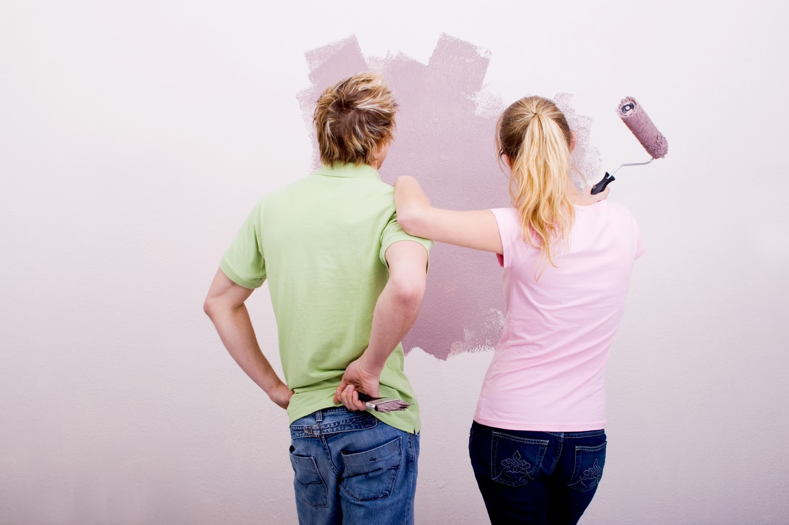 bigstock-Couple-painting-home-5695270