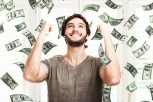 very-happy-young-man-in-a-rain-of-money